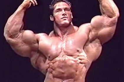 Bodybuilder showing muscle gain